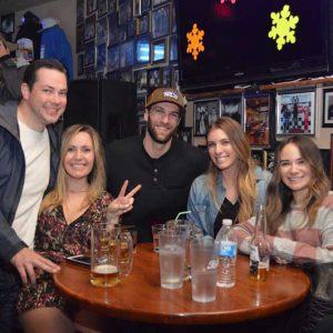 patrons enjoying some cervezas